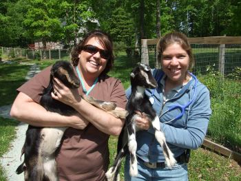 Dr. Jenny Parrish of Local Mobile Veterniary Service and her assistant with goats